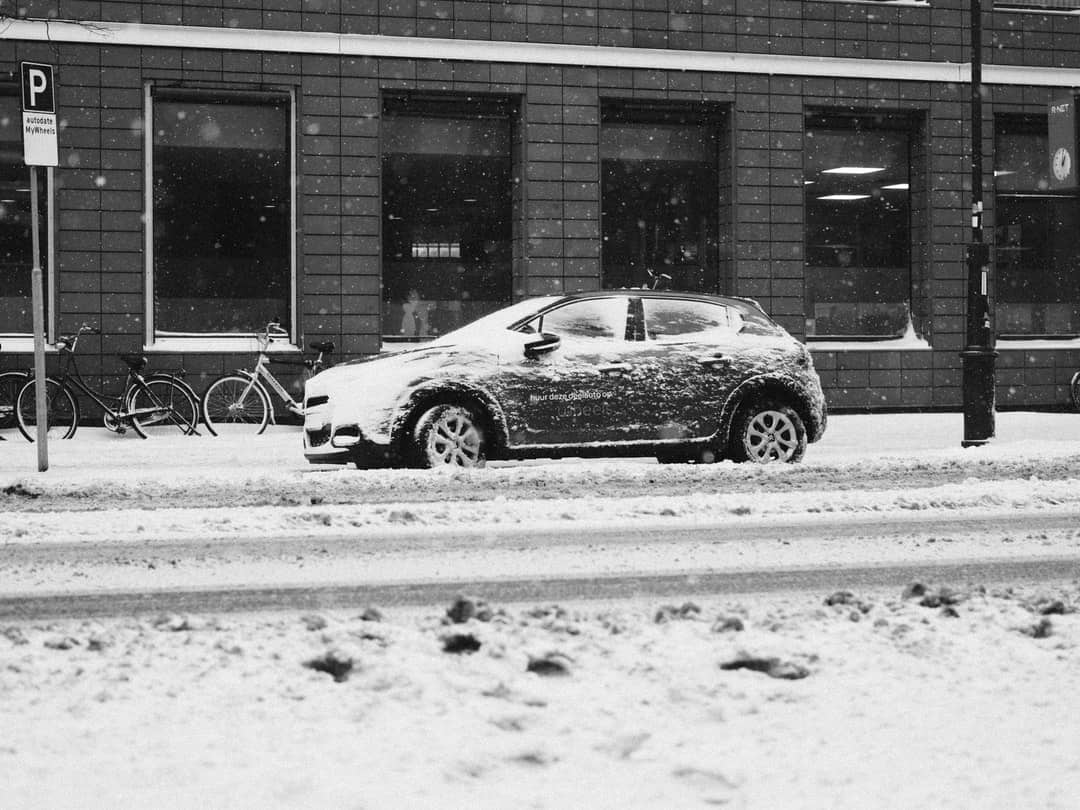 A car parked in front of a building